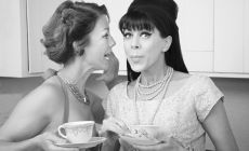 1960s style women gossiping in a kitchen - black and white photo