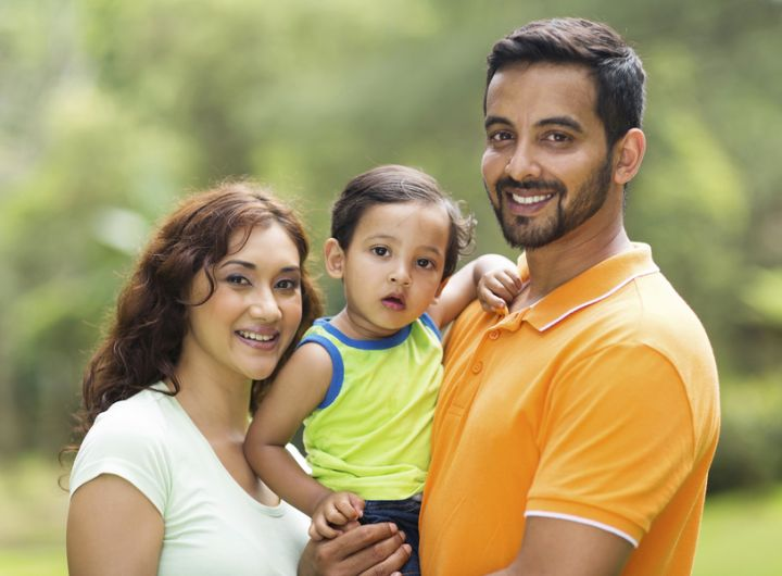 Youth family (mother, father, child) of South Asian appearance